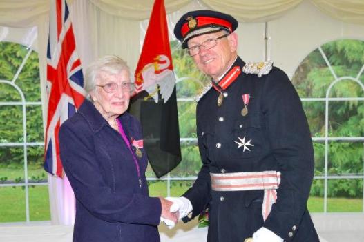 Christian volunteer receives British Empire Medal